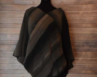 Warm, handwoven poncho in taupe, grey and black.