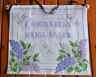 Very well done vintage 1980s handmade white aida cotton cross-stitch IN SUMMER SUNNYDAYS text and lilacs motive embroidery wall-hanging