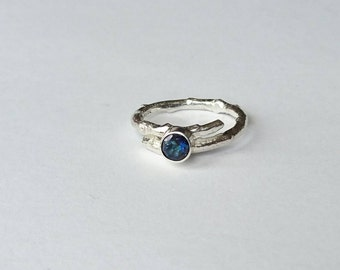 Sterling silver handmade twig style ring with 5m marine blue quartz faceted stone, hallmarked in Edinburgh