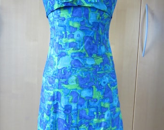 Amazing authentic late 50s early 60s cotton day dress with front bow detail. Mad Men