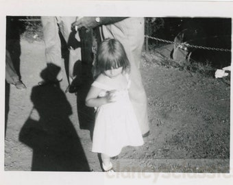 vintage photo 1960 shadow looms over little girl next to headless smoking man abstract