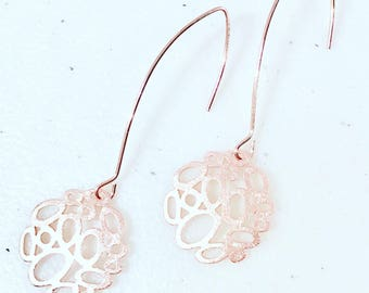 Rose gold bubbles on artisan ear wires.
