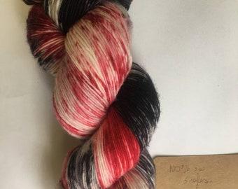 100/superwash merino, singles, hand dyed yarn, hand painted yarn, indie dyed yarn, black and  red