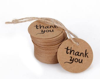 "10 round kraft with string ""thank you"" tag"