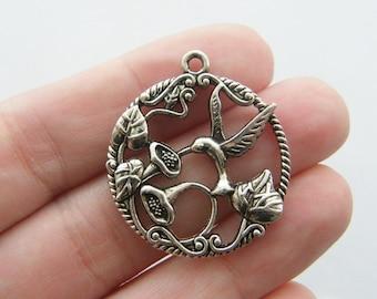 4 Humming bird charms antique silver tone B24