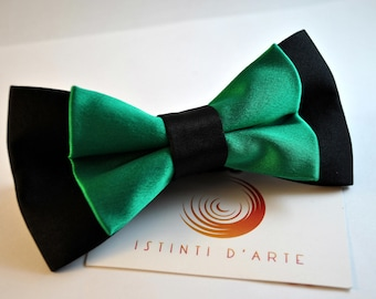 Handmade bow tie for men made up of black and green fabric.