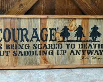 courage is being scared to Death but saddling up anyway. John Wayne sign. Pallet art