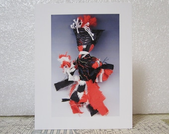 Note card of photo of a fabric doll made by Voszi, VOZ23