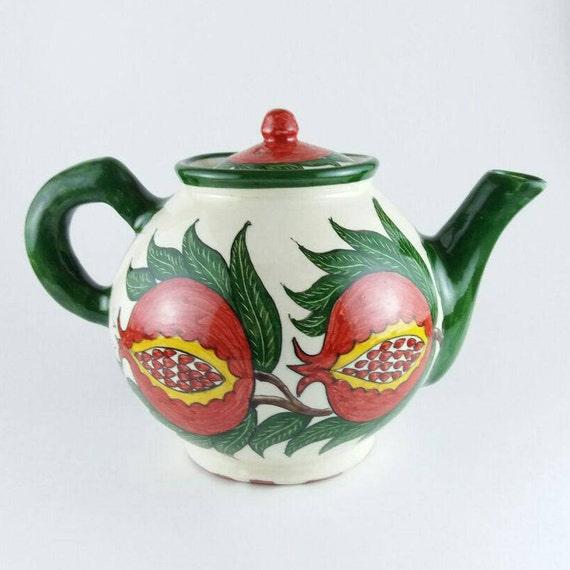 Weiße Teekanne rote und weiße teekanne große rote granatapfel teekanne