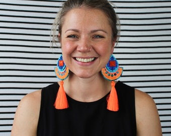 COLOURFUL STATEMENT EARRINGS in tropical turquoise and neon orange. Featuring silky fluorescent tassels. Festival fashion. dakota rae dust