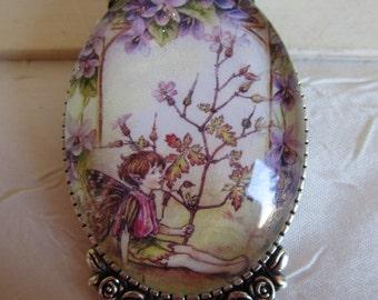 """Broche en métal argenté """"Un charmant petit elfe des fleurs mauve"""""""