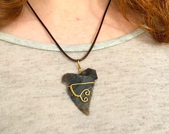 Flint arrowhead pendant with gold wire-wrapped design