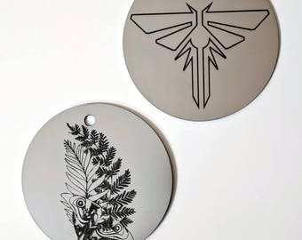 The Last of Us Christmas tree ornament, metallic silver. Fireflies symbol and Ellie's tattoo from TLOU2, laser engraved. TLOU TLOUp2
