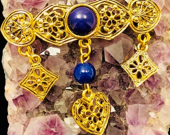 Filigree brooch with blue bead details and dangles
