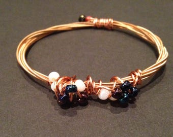 Recycled Acoustic Guitar String Bracelet/Bangle: with blue and white beads.
