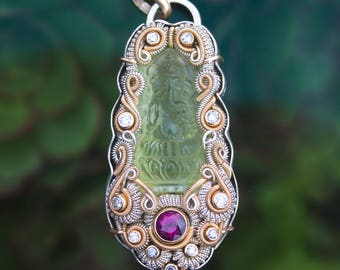 A diety dwells // heliodor Ganesha carving // purple garnet // diamonds // silver 14 kt gold 18kt gold // wire wrap jewelry