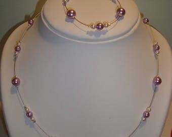 Costume jewelery set and simple purple and white