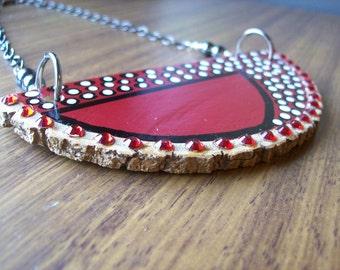 Wood pendant.Golden Ash. Maroon slice. Red rhinestones. Hematite.