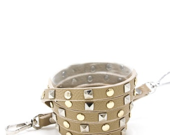 Taupe crossbody strap with gold and silver studs
