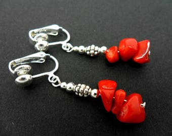 A pair of cute little red coral chips dangly clip on earrings.