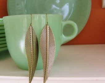 Long feather earrings in antiqued bronze. Large olive leaf pendants.