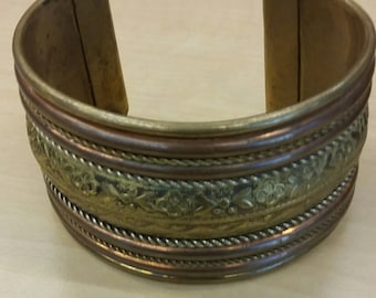 Embossed brass and copper cuff bracelet