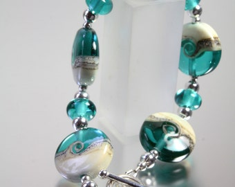 Sterling silver and lampwork bead teal green bracelet from the Coast to coast range by Helen Gorick