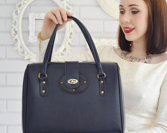 Vintage 1960s Dark Blue Vinyl Handbag in Faux Leather with Gold Tone Metal Hardware by Dove