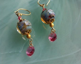 A Murano glass bead hand crafted with a Lampwork and embellished with pink Swarovski crystals