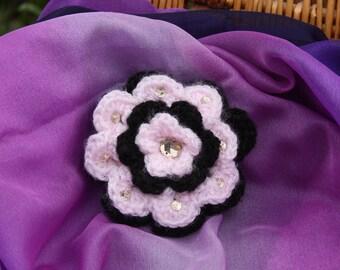 A lovingly crocheted sequin flower brooch, pretty pink