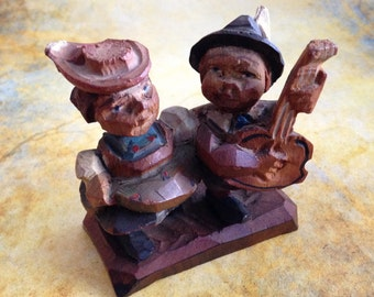 Vintage carved wooden pair