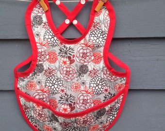 Waterproof PUL baby bib, adjustable, red flower print with snaps and pocket