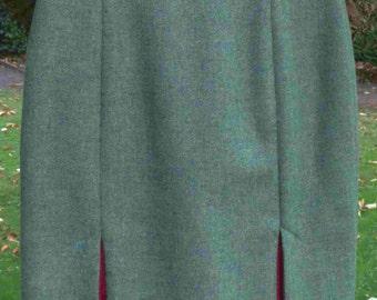 Sea Green Wool Tweed skirt with a vintage twist. Pink accent kick splits.