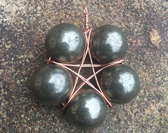 Copper wire wrap star/pentagram/pentacle pendant with pyrite beads.