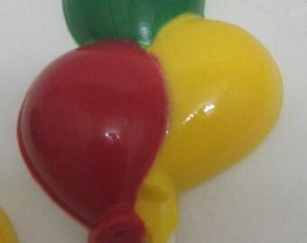 One dozen triple balloon pops