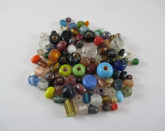 Glass beads, different shapes and different colors.