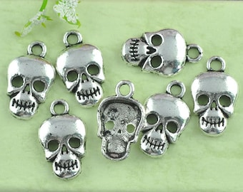 5 Antiqued Silver Tone Skull Charms/Pendants