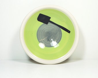 small dish, with a spatula (some call it a scraper spatula) shown here on a color block of tinda & storm, made to order.