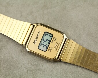 Vintage Advance digital watch with gold tone case and bracelet