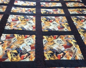 Film Noir. Old movie posters is the theme of this quilt. Quilted in the ditch as well as machine quilted on boarders. Fits a full size bed