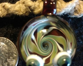 """Eyes of the world"""" hand blown glass pendant on an adjustable hemp necklace. One-of-a-kind!"""