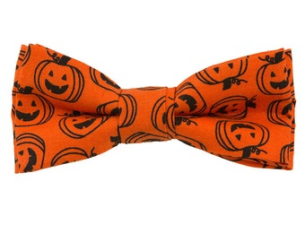 Halloween Bowtie Orange cotton Black printed pumpkins Clip on 4 1/2 inches by 2 inches Handmade Bow tie