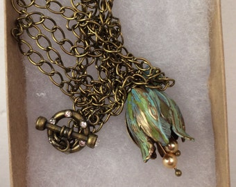 Vintage Tulip II necklace. Hand painted Vintaj tulip with Swarovski crystals and fresh water pearls.