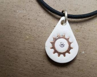 Concrete, small pendant with copper gear