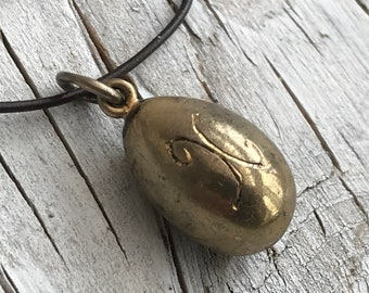 Vintage egg shape pendant with X engraving on one side. Simple pendant of a good weight.