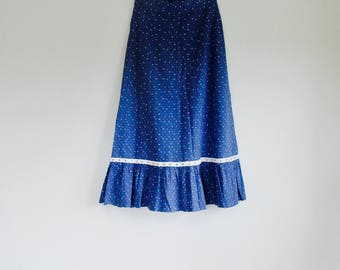Blue peasant novelty print skirt. Fits a size  x-small - small