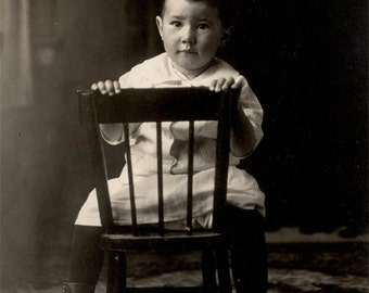 vintage photo 1916 Little Baby Boy Sits Backward on Chair Button Boots RPPC