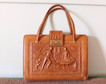large vintage tooled leather purse, made in Mexico . Montiel embossed dancers and Mayan calendar, caramel brown