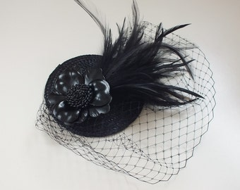 Black Birdcage Veil Net Fascinator with black leather flower brooch detail and black coq and goose biot feathers