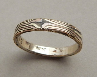 Yellow and Rose gold with sterling silver Mokume-gane band